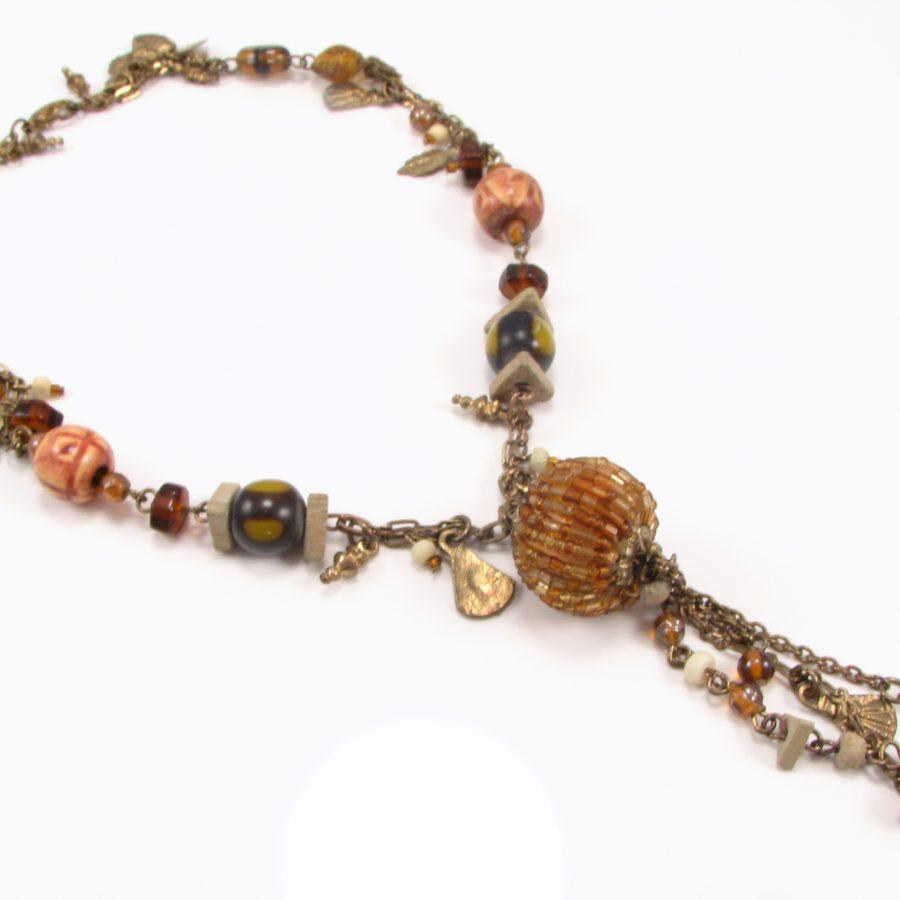 Unika med brunlige perler